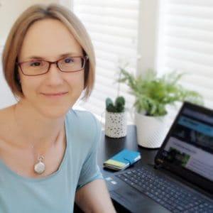 Marci Kobayashi at her computer at marcikobayashi.com